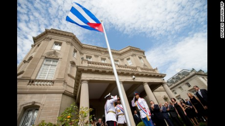 Cuban Foreign Minister Bruno Rodriguez, right of center, applauds with other dignitaries after raising the Cuban flag over their new embassy in Washington, Monday, July 20. Cuba's flag was hoisted Monday at the country's embassy in Washington in a symbolic move signaling the start of a new post-Cold War era in U.S.-Cuba relations.