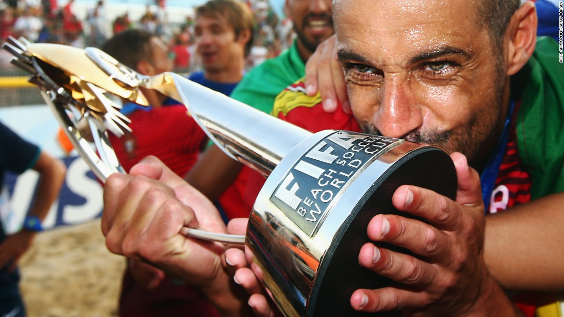 Portugal's Madjer kisses the trophy after his country won the Beach Soccer World Cup on Sunday, July 19. Portugal defeated Tahiti 5-3 in the final, which took place in the Portuguese city of Espinho.