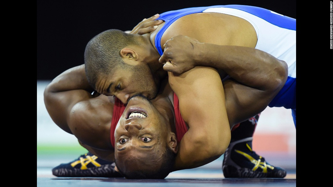 Cuba's Yasmany Lugo, top, pins down Kevin Mejia of Honduras during a Greco-Roman wrestling match Thursday, July 16, at the Pan American Games. Lugo won the gold medal in his weight class.