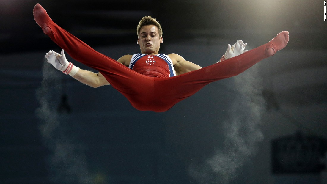Trails of chalk follow the hands of U.S. gymnast Sam Mikulak as he rises above the horizontal bar Wednesday, July 15, at the Pan American Games.