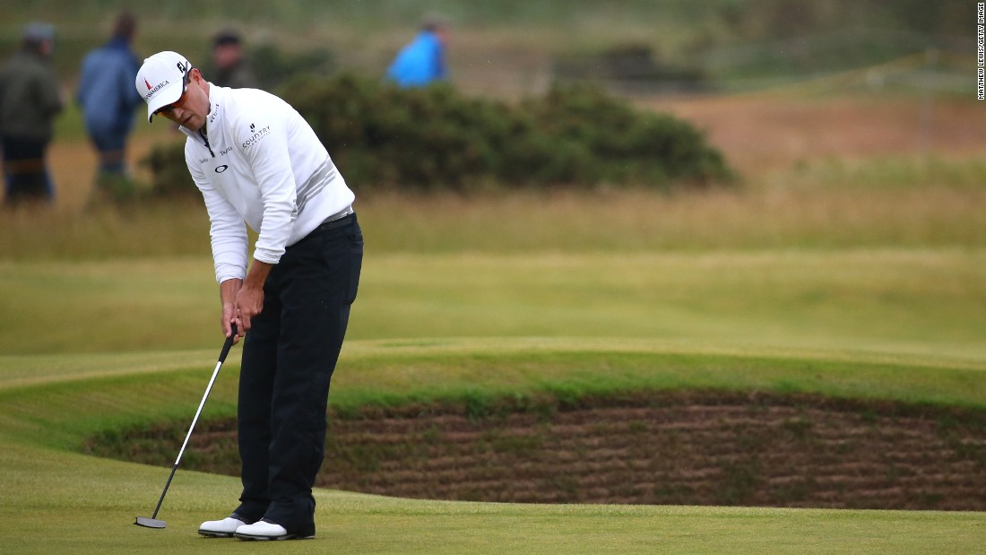 Here Johnson putts on the 14th green during the final round on The Old Course. The Open carries a $10,000,000 purse.