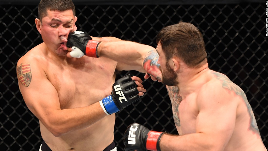 UFC heavyweight Daniel Omielanczuk punches Chris De La Rocha during their bout in Glasgow, Scotland, on Saturday, July 18. Omielanczuk won in 48 seconds.