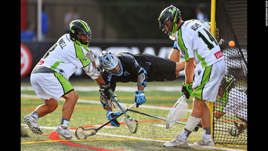 Goalie Drew Adams of the New York Lizards makes a save on Marcus Holman of the Ohio Machine during a Major League Lacrosse game Saturday, July 18, in Delaware, Ohio.
