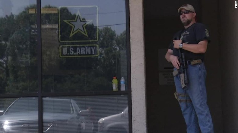 Armed man stands guard at recruitment center