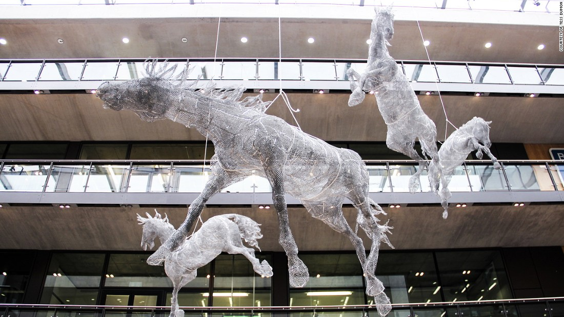 Tess Dumon's life-size horse sculptures were suspended from the ceiling in the atrium at London's Central St. Martins art school.