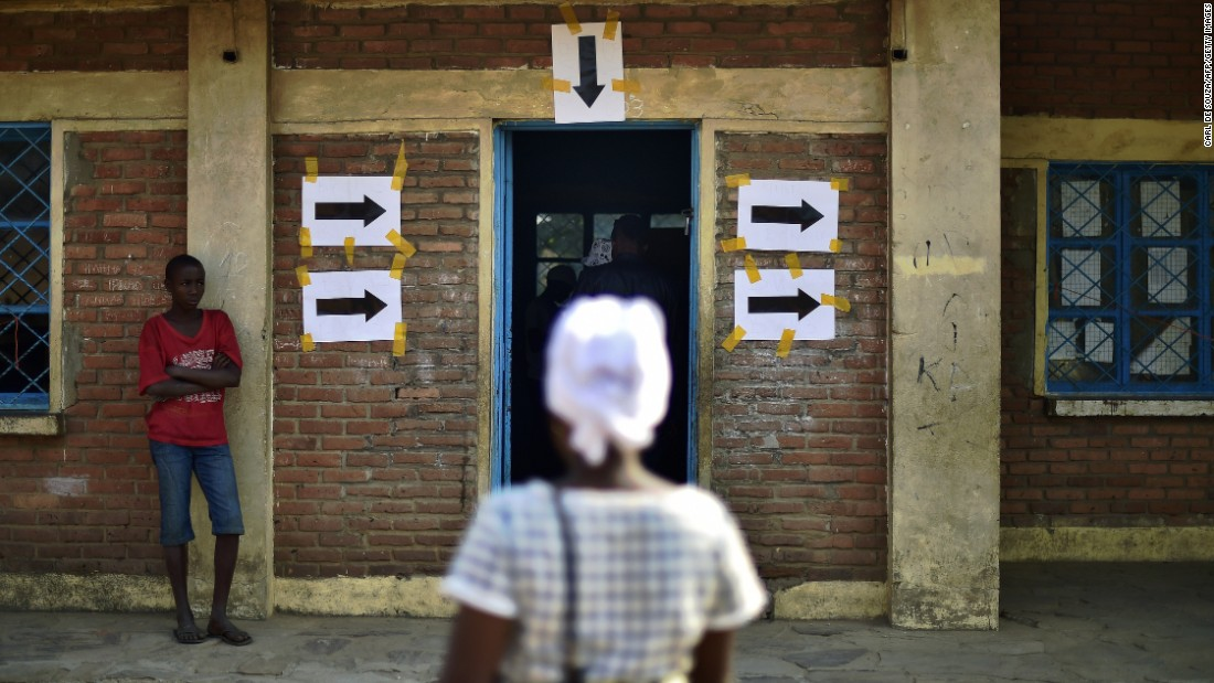 A woman arrives at a polling station in Bujumbura on July 21.