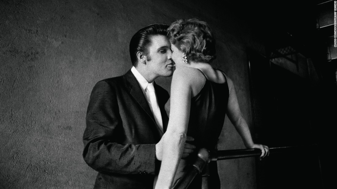 "One of the most famous photos of early Elvis is this one, known as ""The Kiss."" It was taken by Wertheimer in Richmond, Virginia, in 1956. For decades, the identity of the woman was unknown -- <a href=""http://www.vanityfair.com/news/2011/08/elvis-kiss-201108"" target=""_blank"">until Bobbi Owens' husband recognized her</a> many years later. The picture has ended up on a variety of Elvis paraphernalia."
