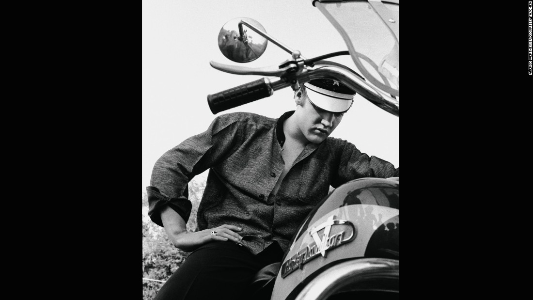 "Also good for the bad-boy image: a motorcycle. This 1956 photo can't help but recall another '50s bad boy, <a href=""https://homespunlondon.files.wordpress.com/2013/11/marlon-brando-the-wild-one-johnny.jpg"" target=""_blank"">Marlon Brando in ""The Wild One.""</a> ""Elvis had animal magnetism,"" singer Ian Hunter said. ""He was even sexy to the guys. I can't imagine what the chicks used to think."""