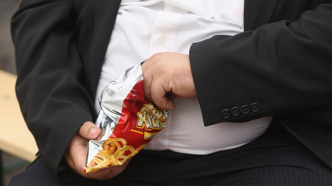 LEIPZIG, GERMANY - MAY 23: A man with a large belly eats junk food on May 23, 2013 in Leipzig, Germany. According to statistics a majority of Germans are overweight and are comparatively heavier than people in most other countries in Europe. (Photo by Sean Gallup/Getty Images)