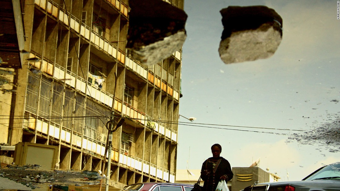 Kiripi Katembo uses photography and video to explore the urban environment. In 2009, he made the photographic series Un Regard, which depicts gritty Kinshasa through puddles. (Pictured: Subir, 2011)