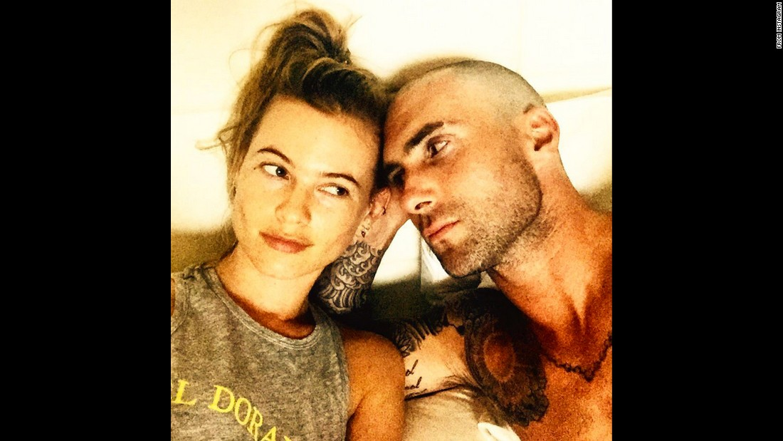 "Maroon 5 frontman Adam Levine shows off his newly shaved head as he takes a selfie with his wife, model Behati Prinsloo, on Tuesday, July 21. ""She's into me...I think...,"" <a href=""https://instagram.com/p/5Y0ZwjKjVn/"" target=""_blank"">he said on Instagram.</a>"
