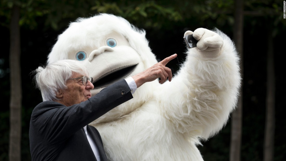 Formula One chief Bernie Ecclestone poses with a person in a Yeti costume Thursday, July 16, in London. Ecclestone was promoting the Mongol Rally, a charity race that starts in England and ends in Russia. The Yeti was the mascot for one of the teams.