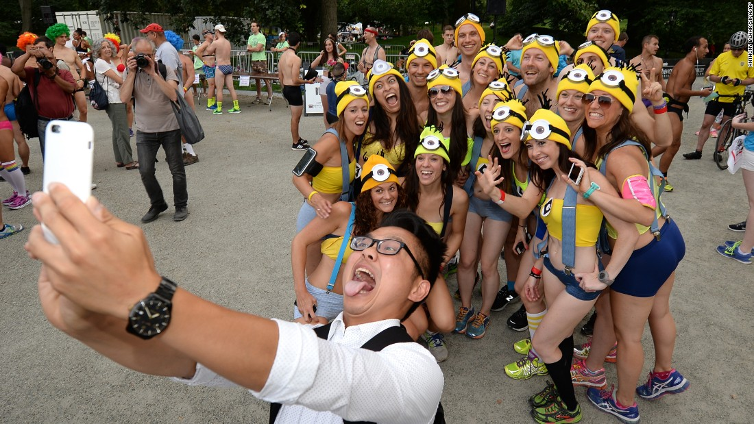 "A man takes a selfie with friends dressed as ""Minions"" before the start of the Underwear Run in New York's Central Park on Friday, July 17."