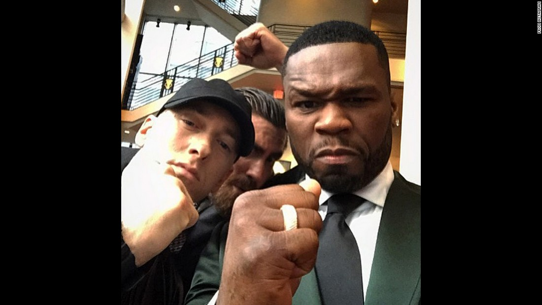 "That's actor Jake Gyllenhaal behind rappers Eminem and 50 Cent in this photo that 50 Cent <a href=""https://instagram.com/p/5YQv4zsL_Q/"" target=""_blank"">posted to Instagram</a> on Monday, July 20. They were putting their fists up to promote the upcoming movie ""Southpaw,"" a boxing movie starring Gyllenhaal and 50."