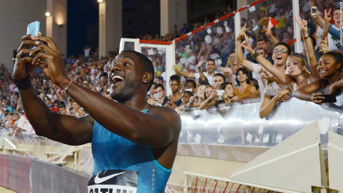 U.S. sprinter Justin Gatlin takes a selfie with fans in Monaco after he won the 100-meter dash at a Diamond League event on Friday, July 17.