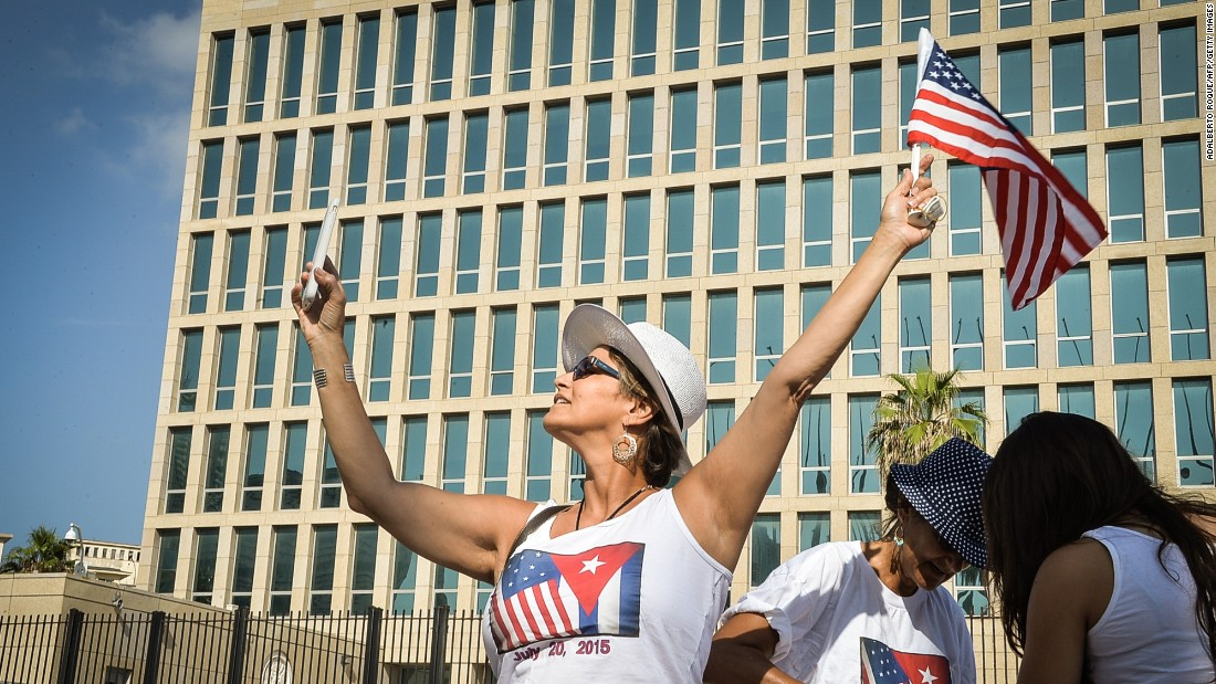 "A tourist holds an American flag in front of the U.S. Embassy <a href=""http://www.cnn.com/2015/07/20/politics/gallery/cuban-embassy-opens/index.html"" target=""_blank"">after it reopened in Havana, Cuba,</a> on Monday, July 20. <a href=""http://www.cnn.com/2015/07/15/living/gallery/selfies-look-at-me-0715/index.html"" target=""_blank"">See 23 selfies from last week</a>"