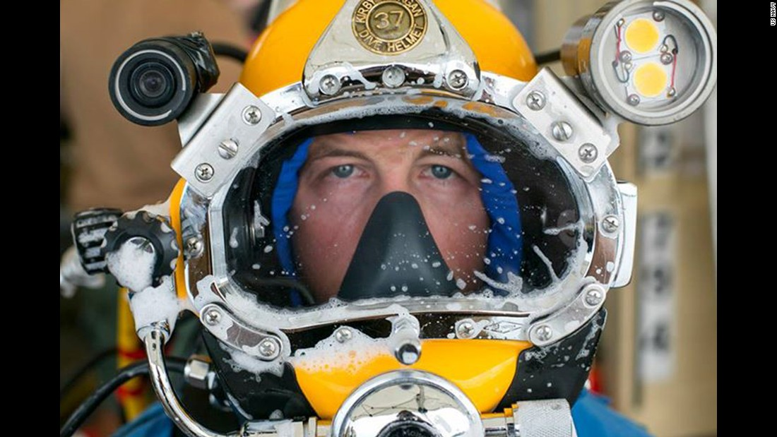 Navy Diver 1st Class Spencer Puett prepares to dive as part of the CSS Georgia salvage operations. About 40 Navy personnel are taking part in the summer salvage operation. Divers have to deal with extremely low visibility.