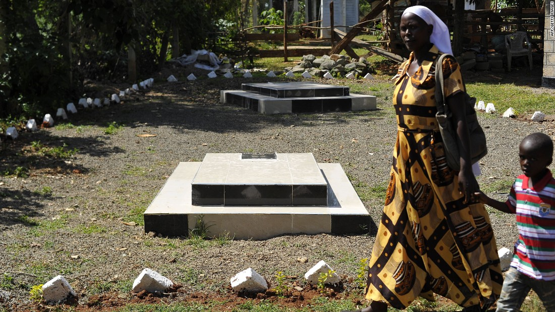 A visitor walks past the graves site of Barack Obama senior at the homestead of Sarah Onyango Obama, the President's step grandmother, at her home in Kogelo, western Kenya.