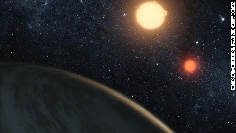 In this digital illustration released on September 15, 2011 by NASA, the newly discovered gaseous planet Kepler-16b orbits its two stars.