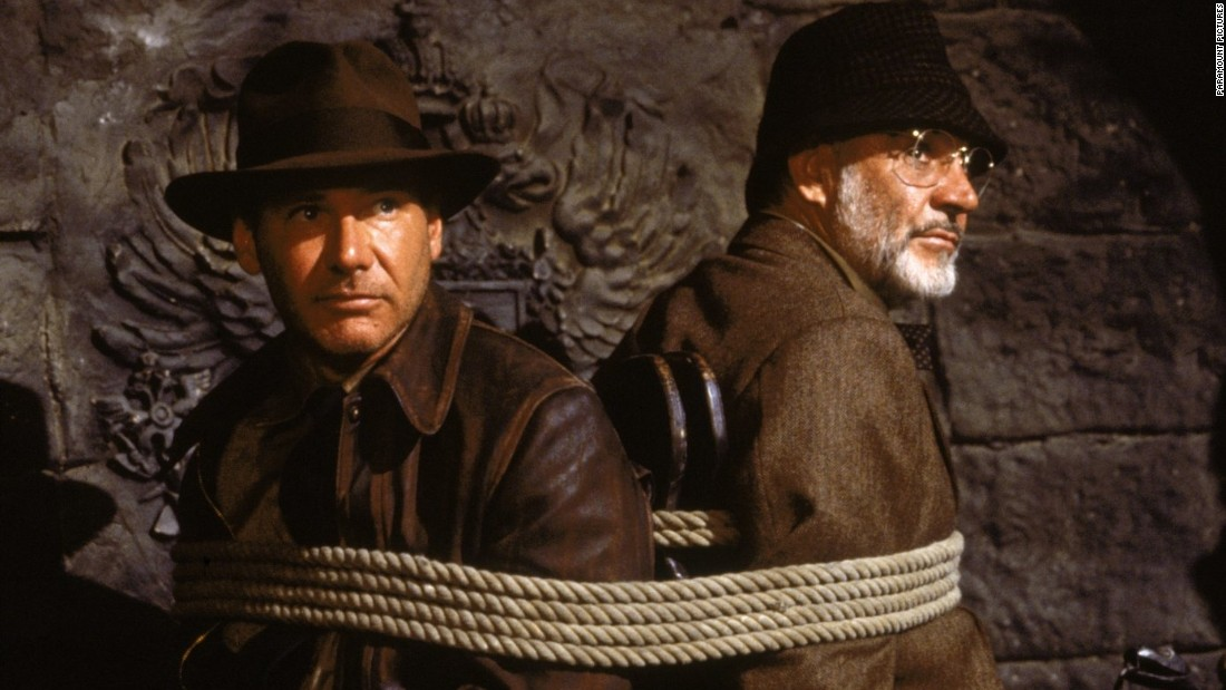 "In 1989's ""Indiana Jones and the Last Crusade,"" the third movie in the series, Harrison Ford's archaeologist/playboy/Nazi-fighter meets up with his father and realizes the proverbial apple doesn't fall too far from the tree (and viewers learn that Indy named himself after the family dog)."