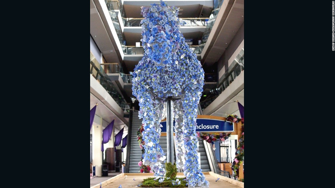 The Ascot sculpture was then festooned with flowers.