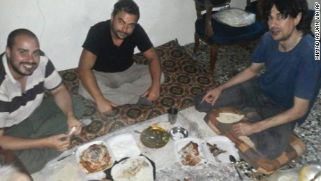This image provided by Ahmad Ajjan, that was posted on Facebook on Saturday, July 11, 2015, shows Spanish freelance journalists Antonio Pampliega, left, Angel Sastre, center, and Jose Manuel Lopez, right, shortly after their arrival in Syria for a reporting trip. Spain said Wednesday, July 22, 2015 that it is trying to establish what happened to the three who went missing around the embattled northern Syrian city of Aleppo. A fourth journalist, a Japanese national, also is presumed missing in Syria. (courtesy of Ahmad Ajjan via AP) MANDATORY CREDIT