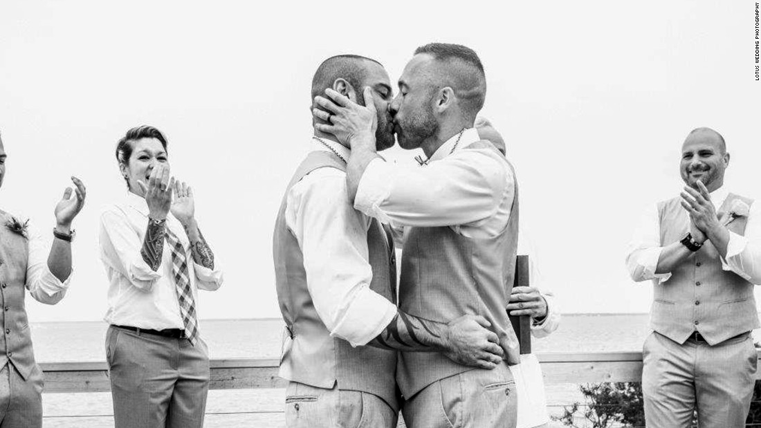 "The timing of the Supreme Court ruling could not have been better for Drew Montalvo, left, and Eric Hanser. A year-and-a-half prior, they set their wedding date for June 27, 2015, without the slightest idea of what was to come the day before. Montalvo is an internationally recognized DJ, but he is in the process of being known by a different name. In what he describes as a progressive effort, Montalvo will be taking his husband's last name. They said ""I do"" on the barrier island of Fire Island Pines in New York, as captured by <a href=""http://www.lotusweddings.net/"" target=""_blank"">Lotus Wedding Photography</a>."