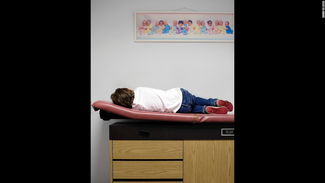 Thomas, suffering from the flu, waits to be seen by his pediatrician in 2014.