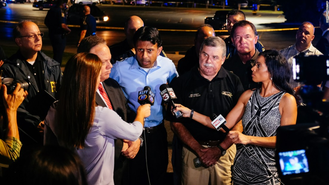 Louisiana Gov. Bobby Jindal, center, speaks with the media near the scene.