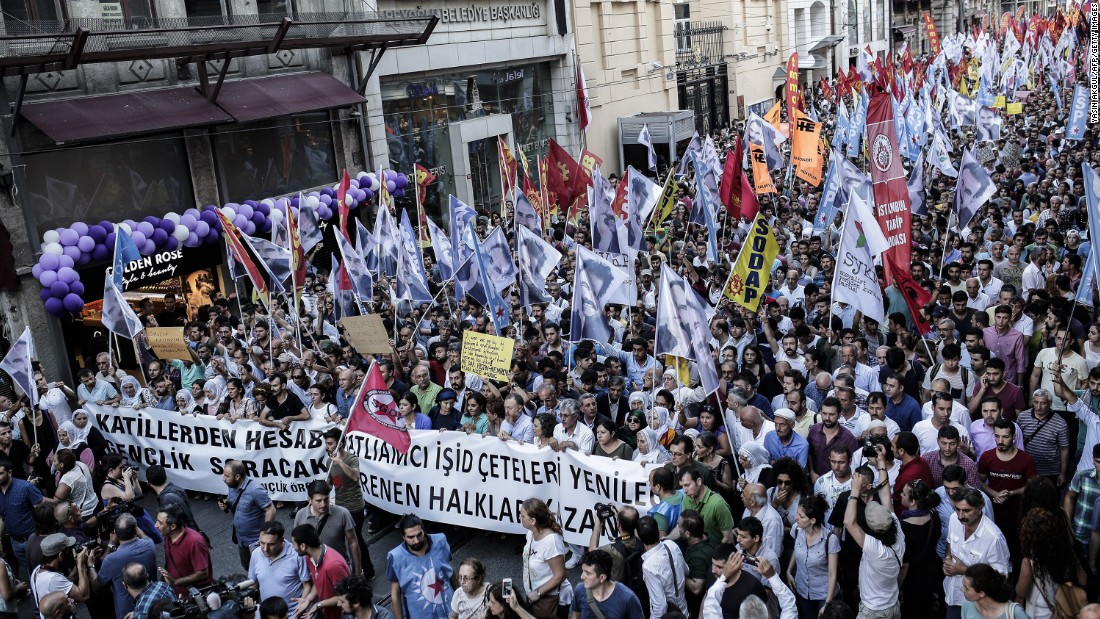 Protesters in Istanbul carry anti-ISIS banners and flags to show support for victims of the Suruc suicide blast during a demonstration on Monday, July 20.