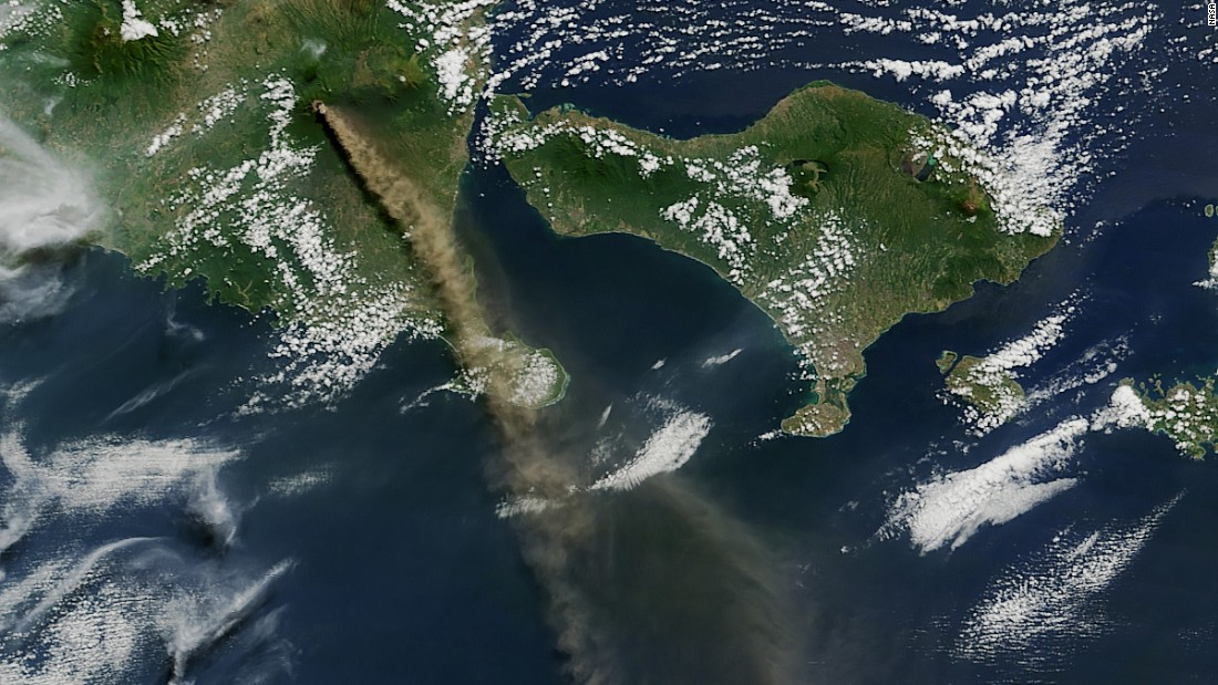 Mt. Raung is seen spewing ash and volcanic gases in this image taken on July 12 by NASA's Aqua satellite. The eruption forced hundreds of flights to and from Bali and other regional airports to be canceled. The ash clouds went as high as 20,000 feet (6 kilometers) into the air.