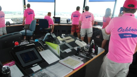Pink-shirted special air traffic controllers staff the tower at Oshkosh's huge aviation festival this week.