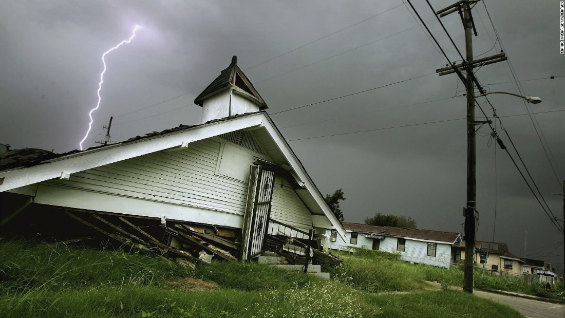 A lightning bolt strikes above a destroyed church in the Lower Ninth Ward on August 5, 2006. Dozens of churches were destroyed by Hurricane Katrina.