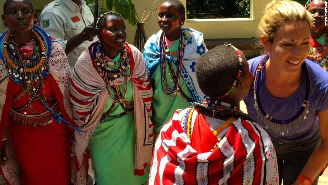Maasai women from a neighboring village greeted Brooke and Lindsay at Sanctuary Olonana with traditional songs.
