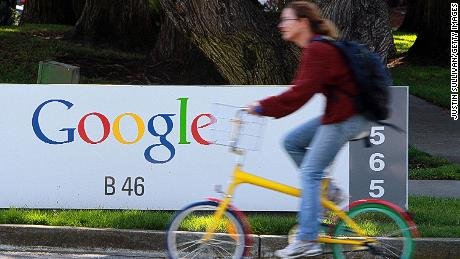 A bicyclist rides by a sign at the Google headquarters March 10, 2010 in Mountain View, California. Google announced today that they are adding bicycle routes to their popular Google Maps and is available in 150 U.S. cities.