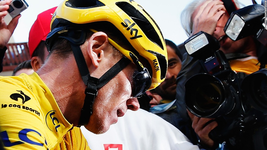 Froome is surrounded by the media after effectively sealing victory by protecting his advantage on the penultimate stage under strong challenge from Quintana.