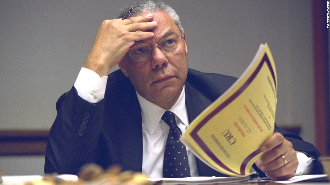"Secretary of State Colin Powell looks over a report. All of the released photos are available in a National Archives <a href=""https://www.flickr.com/photos/usnationalarchives/sets/72157656213196901"" target=""_blank"">Flickr album</a>."