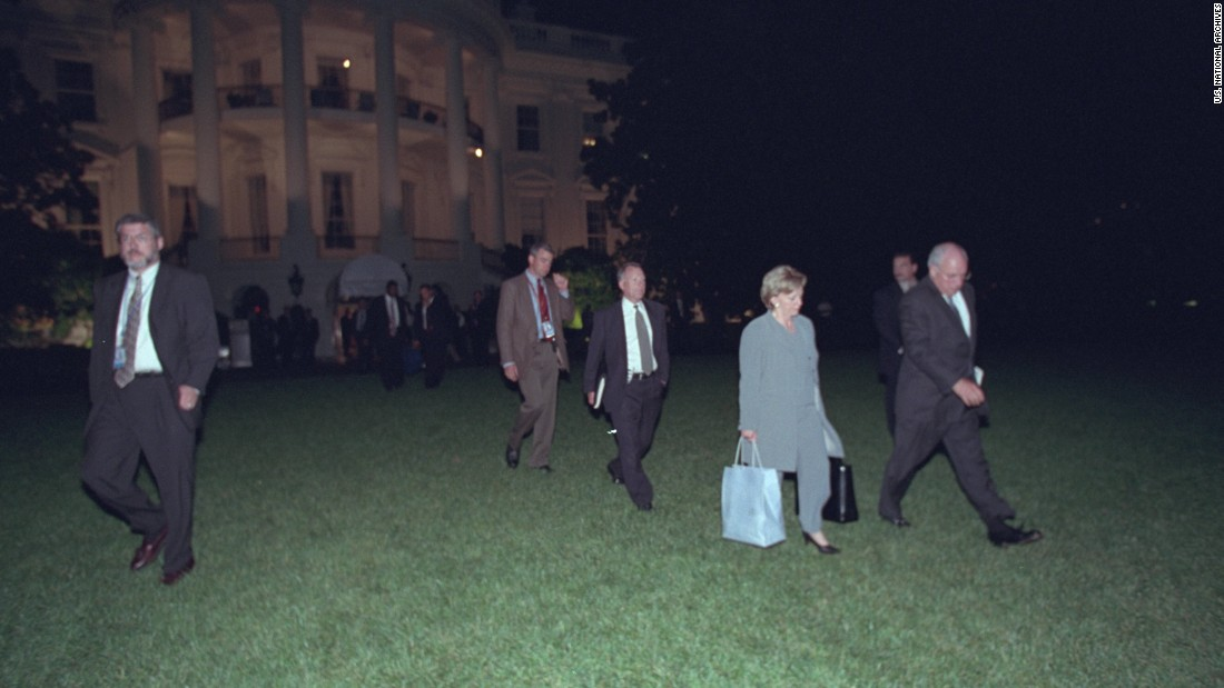 "The Cheneys depart the White House and prepare to board Marine Two. He later took a nighttime ride past the heavily damaged Pentagon. ""I recall watching the vice president, who was staring out the window at the Pentagon, and wondering what he may be thinking about, the responsibilities he would have in the future. A pretty sobering moment,"" said Libby, his chief of staff."