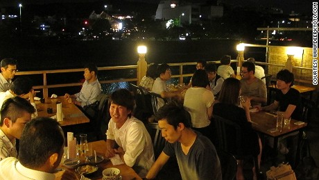 Nighttime balcony (yuka) dining is a summer tradition in Kyoto.