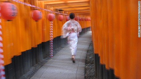 A typical shot in the vermilion tunnels of Fushimi Inari Taisha Shrine.