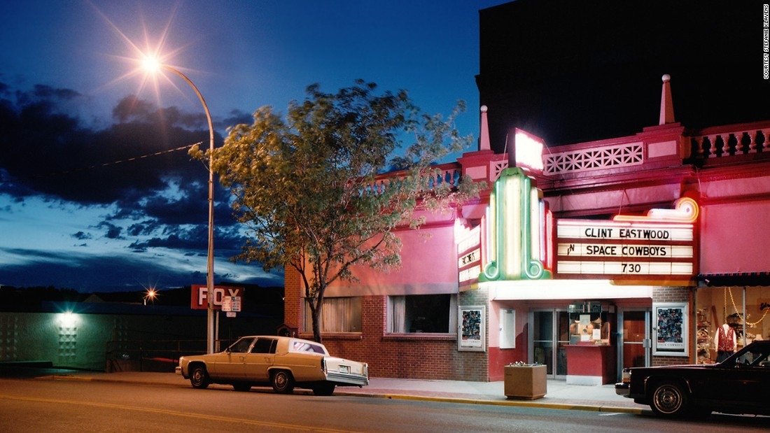 "This single-screen movie theater opened in 1908 with the stage play ""The Bondman.""<br />""These lavish theaters offered moviegoers an escape from hard times into a world of illusion during the Depression,"" according to Klavens' <a href=""http://www.stefanieklavens.com/theaters-and-drive-ins"" target=""_blank"">artist statement</a>. <br />""But as the post-World War II boom fed migration to sprawling suburbs, many downtown palaces fell into disrepair or closed,"" she said.<br />""Multiplexes later presented stiff competition for single-screen theaters by offering a choice of films at one convenient location. The downtown theater, with only one auditorium and screen, could no longer compete."""