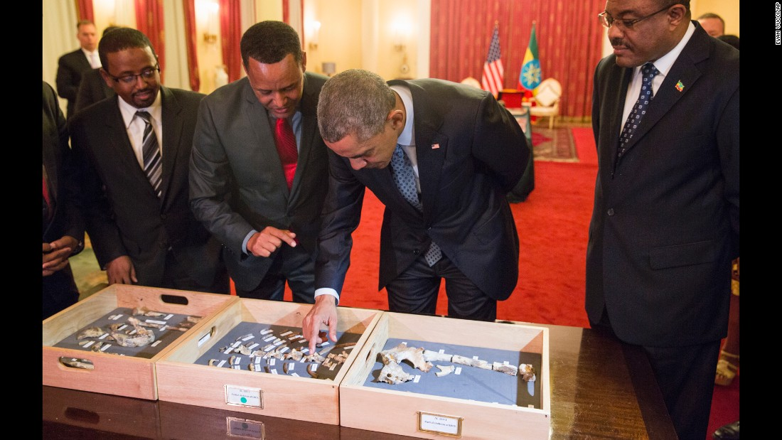 "Desalegn, right, watches as Obama touches the ""Lucy"" exhibit at the National Palace on July 27. ""Lucy"" is made up of several hundred pieces of bone representing 40% of a female Australopithecus afarensis, a human-like species estimated to have lived in Ethiopia 3.2 million years ago."