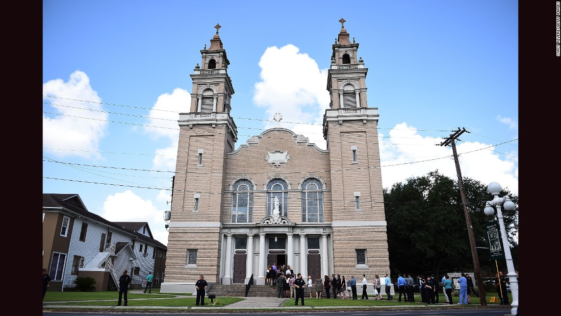 Two people were killed and nine wounded on July 23 when John Russell Houser opened fire in a theater before killing himself, according to police. This is the Church of the Assumption before the funeral of Mayci Breaux, on Monday, July 27, in Franklin, Louisiana. Click through the gallery for more photos from the funerals: