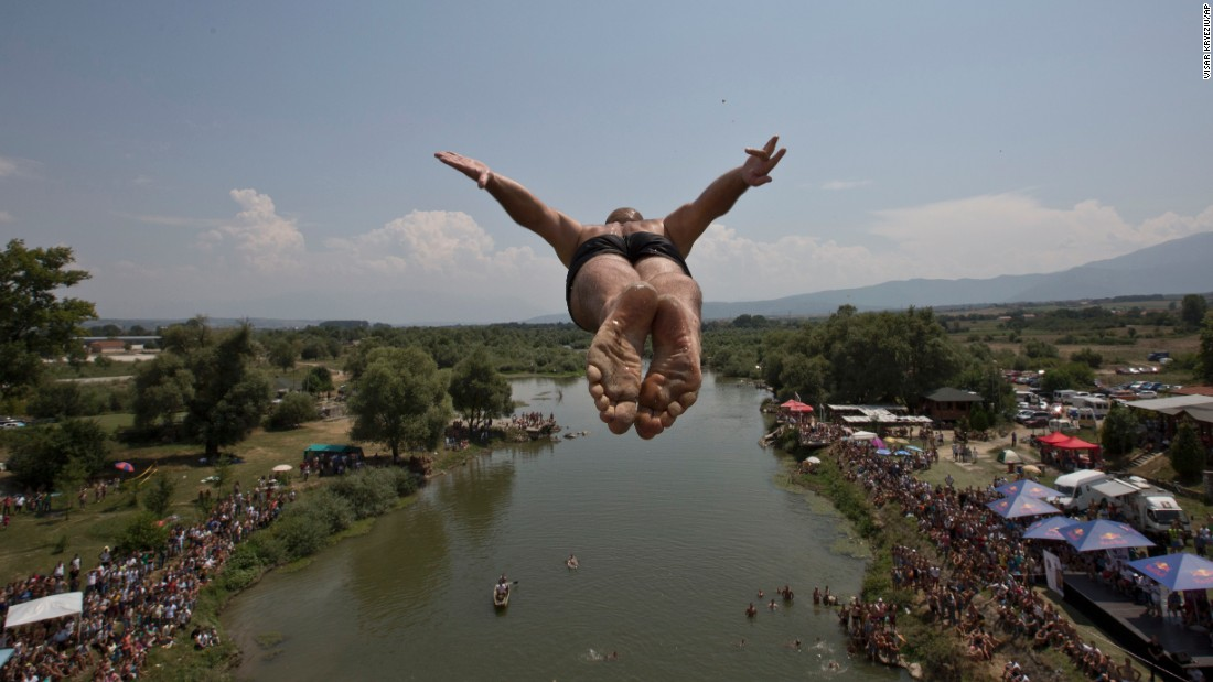 A competitor jumps from the Saint Bridge near Gjakova, Kosovo, during a high-diving competition on Sunday, July 26.