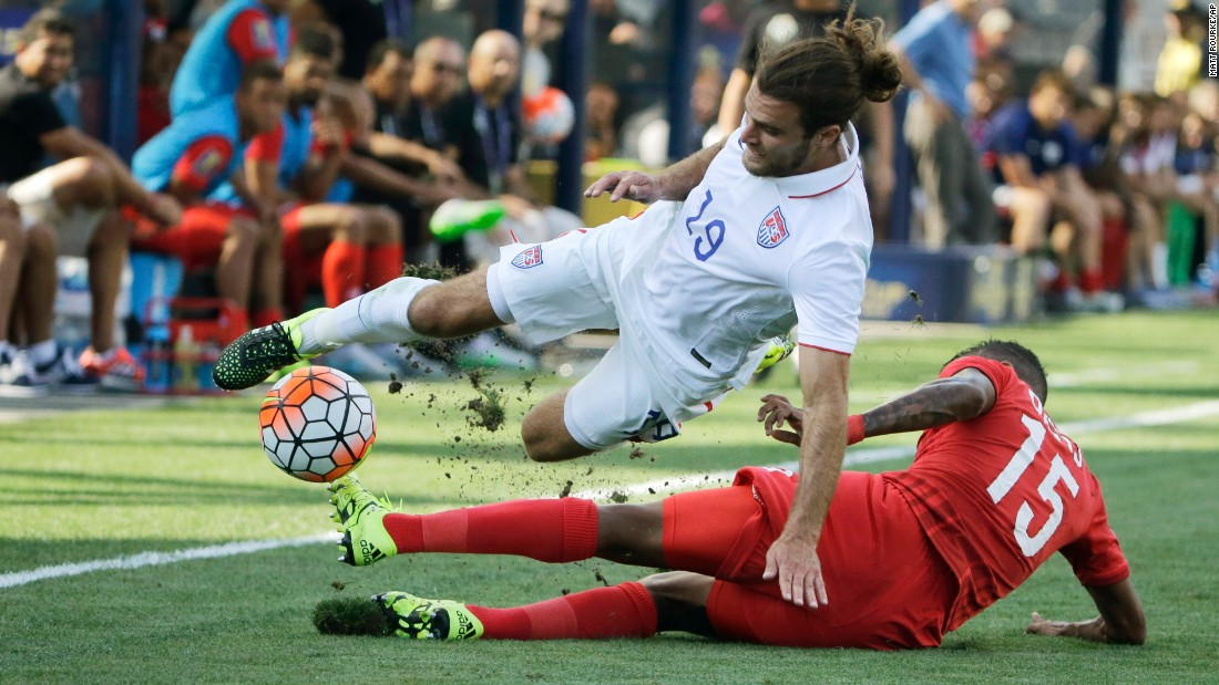 Panama's Erick Davis, bottom, tackles American Graham Zusi during the Gold Cup third-place match, which was played in Chester, Pennsylvania, on Saturday, July 25. Panama won on penalties.