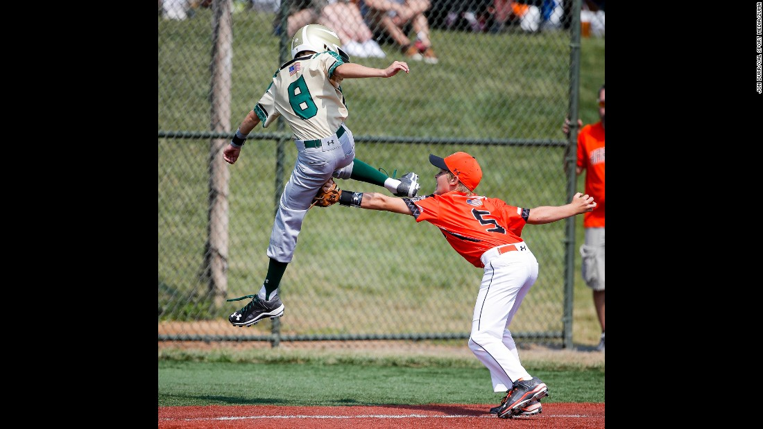 Austin Carr tags Grayson Nichols during a youth baseball game played Sunday, July 26, in Aberdeen, Maryland. The game was part of the Cal Ripken World Series.