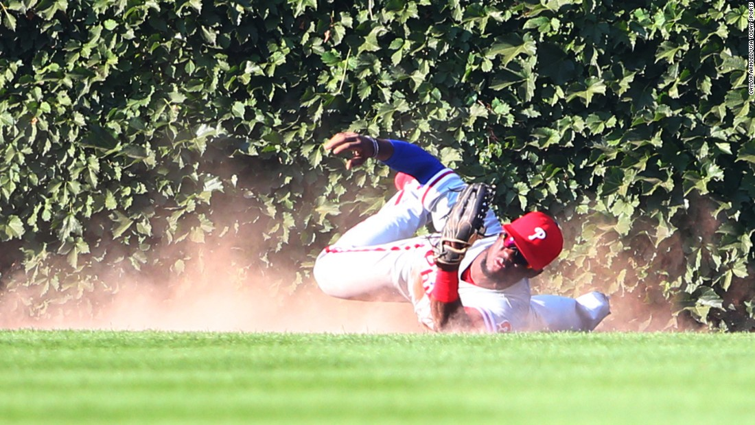 Philadelphia outfielder Odubel Herrera makes a diving catch to clinch a no-hitter for teammate Cole Hamels on Saturday, July 25. Hamels shut out the Chicago Cubs 5-0. It was his first career no-hitter.