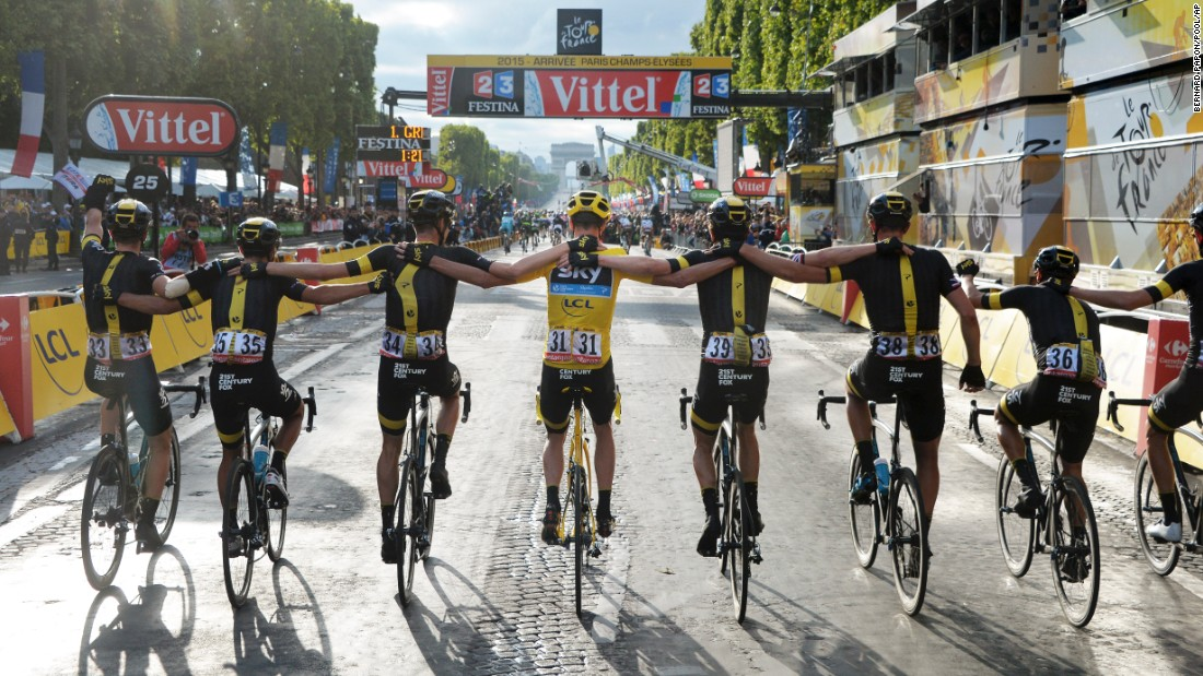 Chris Froome and the rest of Team Sky cross the finish line together at the Tour de France on Sunday, July 26.