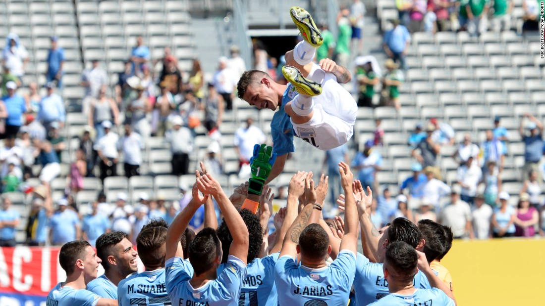 Brian Lozano is thrown into the air by his teammates after Uruguay won the gold-medal soccer match at the Pan American Games on Sunday, July 26. Lozano scored the only goal of the match.