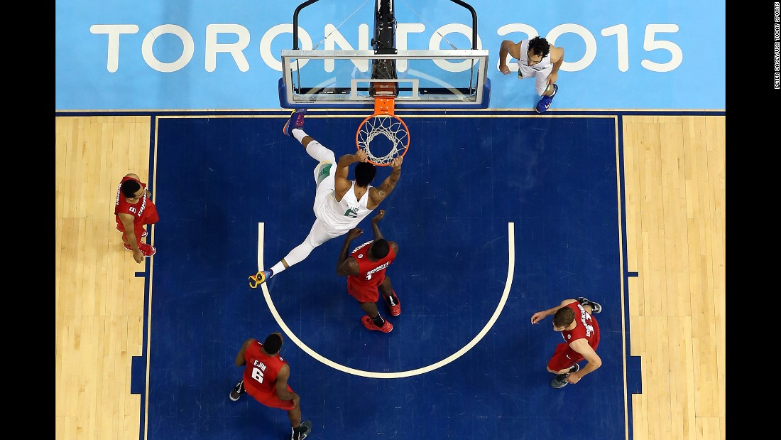 Brazil center Augusto Lima dunks the ball against Canada in the final of the Pan American Games on Saturday, July 25. Brazil won 86-71.